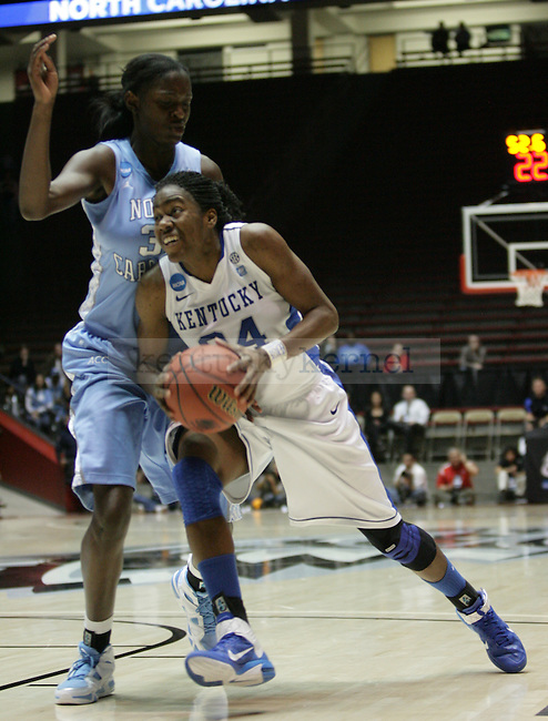 UK Hoops' senior forward Victoria Dunlap attempts to go up for a layup against North Carolina's Waltiea Rolle in the first half of UK Hoops' second round NCAA game against UNC in The Pit in Albuquerque, New Mexico, 3/21/11. Photo by Brandon Goodwin | Staff.