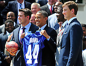 United States President Barack Obama welcomes the Super Bowl Champion New York Giants to the White House in Washington, D.C. on Friday, June 8, 2012.  Left to right: Zak DeOssie, President Obama, Justin Tuck, and Eli Manning..Credit: Ron Sachs / CNP.(RESTRICTION: NO New York or New Jersey Newspapers or newspapers within a 75 mile radius of New York City)