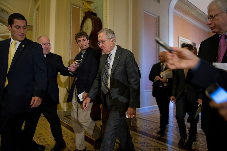 UNITED STATES - Oct 15: Senate Majority Leader Harry Reid, D-NV., walks from Senate Minority Leader Mitch McConnell, R-Ky., office after a meeting in the U.S. Capitol on October 15, 2013. (Photo By Douglas Graham/CQ Roll Call)