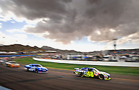 Nov. 9, 2008; Avondale, AZ, USA; NASCAR Sprint Cup Series driver Jimmie Johnson (48) leads a pack of drivers during the Checker Auto Parts 500 at Phoenix International Raceway. Mandatory Credit: Mark J. Rebilas-