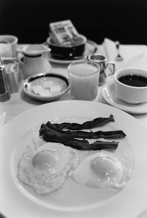 Power breakfast with two eggs sunny side up with 3 strips of bacon at French restaurant, La Colline, on April 8, 1996. (Photo by Laura Patterson/CQ Roll Call via Getty Images)