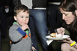 Fund raiser for firefighter Ray Pfeifer on Saturday, March 31, 2012, at East Meadow Firefighters Benevolent Hall, New York, USA. Rockland County toddler Brian Lavan (left) was with his mother Carolyn Lavan (right) and his father, a member of Ladder 11 in Manhattan.