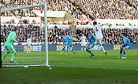 SWANSEA, WALES - FEBRUARY 07: Ki Sung Yueng of Swansea (R) scores a goal only to be disallowed by the referee as an offside during the Premier League match between Swansea City and Sunderland AFC at Liberty Stadium on February 7, 2015 in Swansea, Wales.