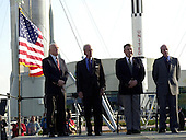 During opening ceremonies for the 40th anniversary celebration of American spaceflight, four space pioneers stand at attention: (from left) John Glenn Jr., Scott Carpenter, Wallly Schirra and Gordon Cooper on February 24, 2002. The site is the Rocket Garden in the KSC Visitor Complex At Cape Canaveral. Florida.Credit: NASA via CNP