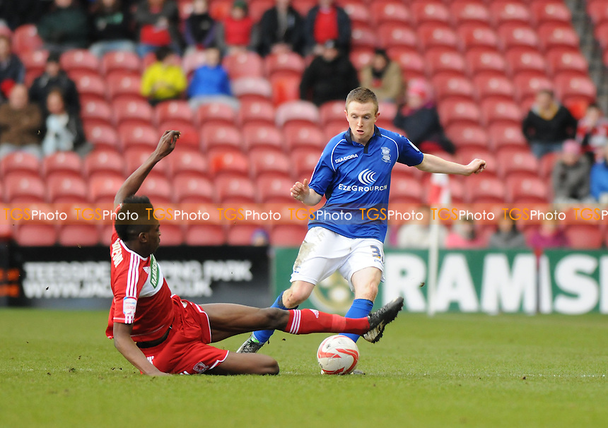 Sammy Ameobi of Middlesbrough tackles Shane Ferguson of Birmingham City - Middlesbrough vs Birmingham City - NPower Championship Football at the Riverside Stadium, Middlesbrough - 16/03/13 - MANDATORY CREDIT: Steven White/TGSPHOTO - Self billing applies where appropriate - 0845 094 6026 - contact@tgsphoto.co.uk - NO UNPAID USE.