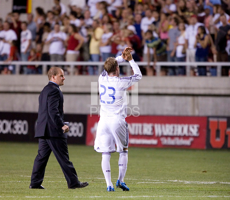 Real Madrid midfielder David Beckham salutes the fans at the end of the Real Madrid 2-0 win over Real Salt Lake at Rice Eccles Stadium in Salt Lake City, Utah August 12, 2006