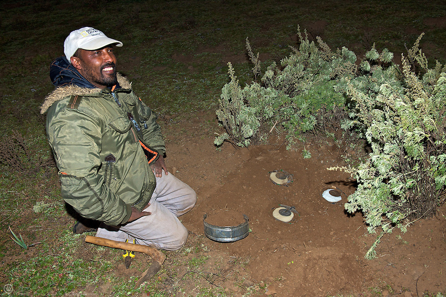 Program manager, Edris Ebu sets a trap in Web Valley to capture wolves in order to collect blood and tissue samples to determine efficacy of a recent vaccine trial.<br /> <br /> Learn more:<br /> http://www.ethiopianwolfproject.com<br /> http://www.ethiopianwolf.org/