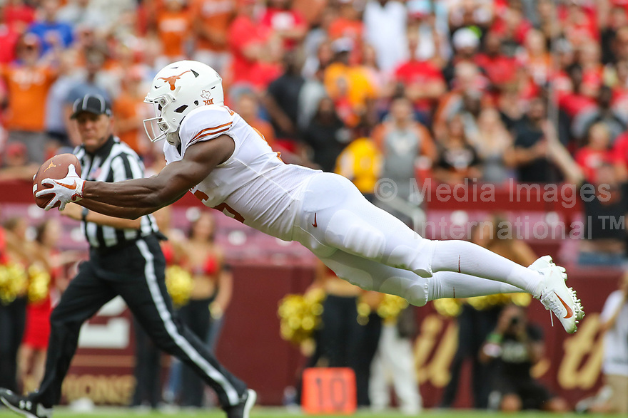 Landover, MD - September 1, 2018: Texas Longhorns wide receiver Devin Duvernay (6) catches a pass for a touchdown during the game between Texas and Maryland at  FedEx Field in Landover, MD.  (Photo by Elliott Brown/Media Images International)