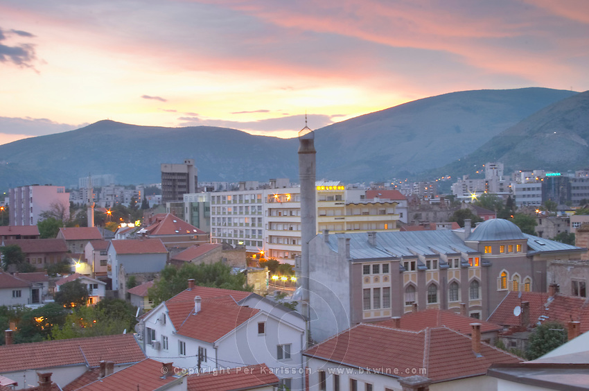 View over the city at sunset. Historic town of Mostar. Federation Bosne i Hercegovine. Bosnia Herzegovina, Europe.