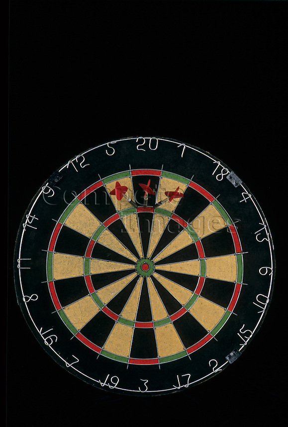 Dart board with three darts in triple 20