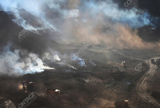 Noxious gases are released every day from burning caol fields, Ordos city, Inner Mongolia, October 5, 2009