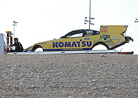 Apr. 6, 2013; Las Vegas, NV, USA: A crew member rides on the tow truck with the body from the car of NHRA funny car driver Tony Pedregon during qualifying for the Summitracing.com Nationals at the Strip at Las Vegas Motor Speedway. Mandatory Credit: Mark J. Rebilas-