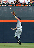 Virginia outfielder Derek Fisher (23) makes a catch in the second inning of an NCAA college baseball tournament super regional game against Maryland in Charlottesville, Va., Sunday, June 8, 2014.  (AP Photo/Andrew Shurtleff)