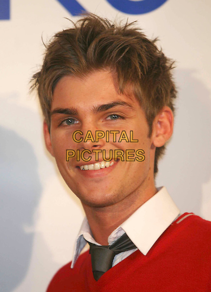 "KIERON RICHARDSON.At the Launch of the ""Hollyoaks"" Perfume, The Eve Club, London, England, UK, September 30th 2008..fragrance cast portrait headshot tie red jumper .CAP/DS.©Dudley Smith/Capital Pictures"