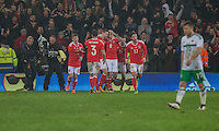 Simon Church of Wales (centre) celebrates scoring his side's equalising goal from the penalty spot during the International Friendly match between Wales and Northern Ireland at Cardiff City Stadium, Cardiff, Wales on 24 March 2016. Photo by Mark  Hawkins / PRiME Media Images.