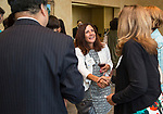 Trustee Renee Togher meets guests, along with DePaul President A. Gabriel Esteban, Ph.D., and his wife Josephine, during a reception Thursday, July 20, 2017, at The Chicago Club. The event was organized to welcome the Estebans to Chicago and introduce them to some of Chicago&rsquo;s most influential women. <br /> (DePaul University/Jamie Moncrief)