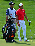 Potomac, MD - June 29, 2017: Rickie Fowler and his caddie Joe Skovron wait to play a shot on the 15th hole during Round 1 of professional play at the Quicken Loans National Tournament at TPC Potomac at Avenel Farm in Potomac, MD, June 29, 2017.  (Photo by Don Baxter/Media Images International)