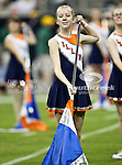 A Illinois Fighting Illini color guard member dances during the pre-game ceremonies before the 2010 Texas  Bowl football game between the Illinois  Fighting Illini and the Baylor Bears at the Reliant Stadium in Houston, Tx. Illinois defeats Baylor 38 to 14....