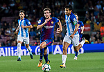 Sergi Roberto Carnicer (l) of FC Barcelona fights for the ball with Roberto Jose Rosales Altuve of Malaga CF  during the La Liga 2017-18 match between FC Barcelona and Malaga CF at Camp Nou on 21 October 2017 in Barcelona, Spain. Photo by Vicens Gimenez / Power Sport Images