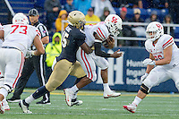 Annapolis, MD - OCT 8, 2016: Navy Midshipmen linebacker D.J. Palmore (45) tackles Houston Cougars quarterback Greg Ward Jr. (1) in the backfield during game between Houston and Navy at Navy-Marine Corps Memorial Stadium Annapolis, MD. The Midshipmen upset #6 Houston 46-40. (Photo by Phil Peters/Media Images International)