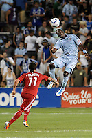 C J Sapong (blue) Sporting KC, Daniel Paladini Chicago Fire...Sporting KC were held to a scoreless tie with Chicago Fire in the inauguarl game at LIVESTRONG Sporting Park, Kansas City, Kansas.
