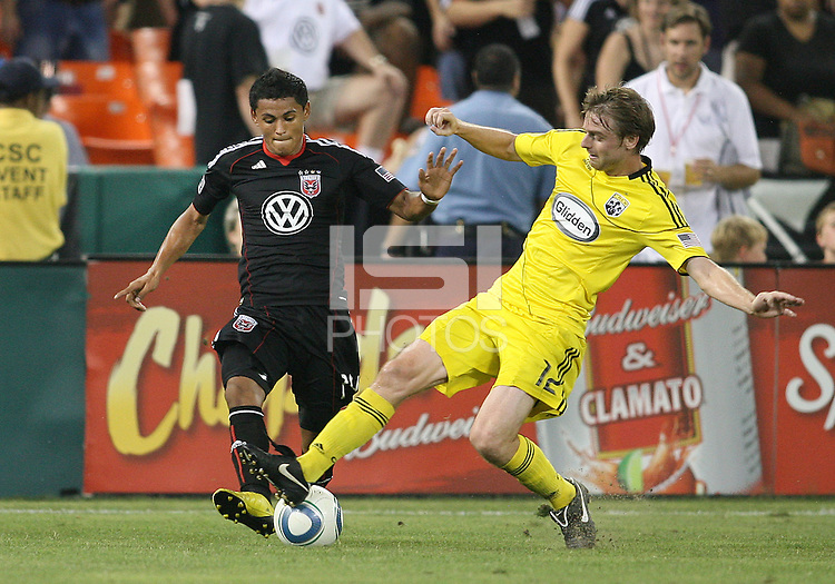 Andy Najar #14 of D.C. United is tackled by Eddie Gaven #12 of the Columbus Crew during a US Open Cup semi final match at RFK Stadium on September 1 2010, in Washington DC. Crew won 2-1.