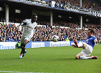 Pictured L-R: Nathan Dyer has his cross stopped by Leighton Baines of Everton. Saturday 22 March 2014<br /> Re: Barclay's Premier League, Everton v Swansea City FC at Goodison Park, Liverpool, UK.