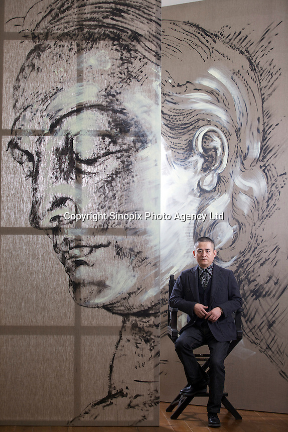 Zeng Fanzhi, China's renowned contemporary artist, poses for pictures between an unfinished painting in his Beijing studio on 9th November, 2012, China. Zeng gained the title of &quot;Number One&quot; Chinese artist in terms of auction price in 2009.<br /> <br /> By Ricky Wong / Sinopix
