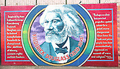 Belfast, Northern Ireland - August 14, 2005 -- Wall murals along Falls Road in Belfast, Northern Ireland on Sunday, August 14, 2005.  Falls Road is in one of the Catholic neighborhoods in Belfast.  The murals reflect their political positions on many national and international issues. This mural celebrates the 19th century American civil rights activist Frederick Douglas.Credit: Ron Sachs / CNP