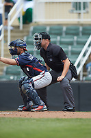 Home plate umpire Colin Baron sets up behind Rome Braves catcher Ricardo Rodriguez (8) during the game against the Kannapolis Intimidators at Kannapolis Intimidators Stadium on April 7, 2019 in Kannapolis, North Carolina. The Intimidators defeated the Braves 2-1. (Brian Westerholt/Four Seam Images)