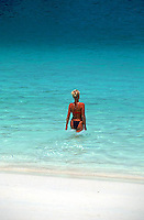 Woman walking into tropical waters, Ko Phi Phi island, Thailand