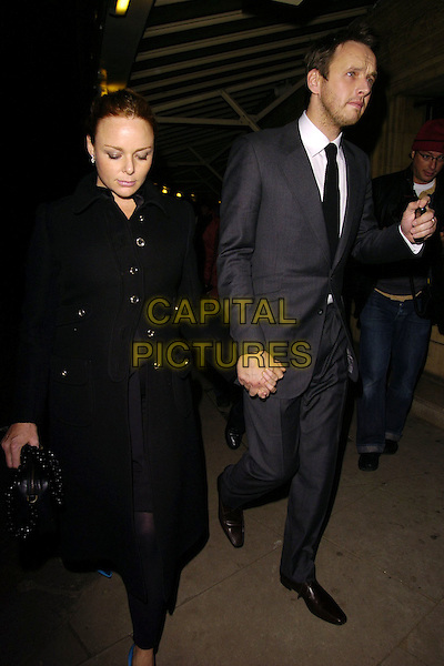 STELLA McCARTNEY & ALASDHAIR WILLIS.At the Paul McCartney Concert,.Royal Albert Hall, London, England, .November 3rd 2006..full length pregnant married husband wife blue turquoise shoes black coat bag alistair holding hands.Ref: CAN.www.capitalpictures.com.sales@capitalpictures.com.©Can Nguyen/Capital Pictures