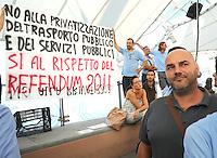 I lavoratori dell'AMT Azienda Trasporti espongono striscioni durante l'intervento del ministro dei trasporti <br /> Genova 04-09-2013 Festa Nazionale Partito Democratico<br /> Photo  Genova Foto /Insidefoto