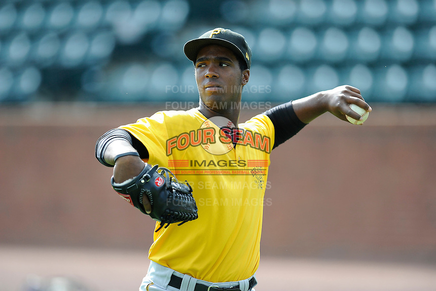 Right fielder Nick Buckner (34) of the Bristol Pirates warms up before a game against the Greeneville Astros on Friday, July 25, 2014, at Pioneer Park in Greeneville, Tennessee. Greeneville won, 9-4. (Tom Priddy/Four Seam Images)