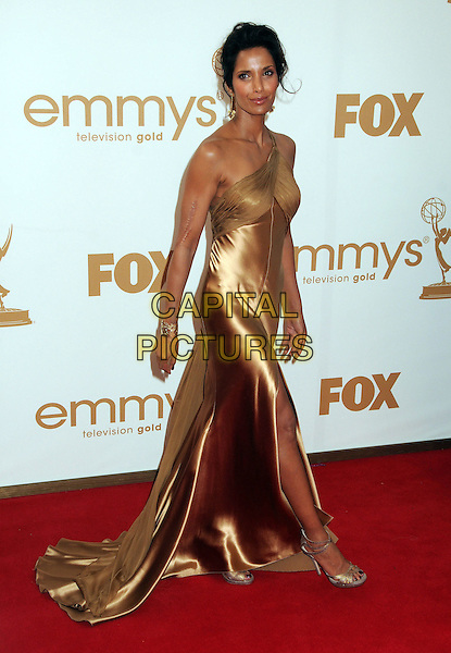 Padma Lakshmi.63rd Primetime Emmy Awards held at Nokia Theatre L.A. Live. Los Angeles, California, USA. .18th September 2011.emmys full length gold one shoulder beige silk satin dress  .CAP/ADM/BP.©Byron Purvis/AdMedia/Capital Pictures.