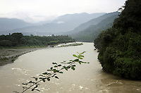 "A view of the the Dujiangyan Irrigation System and surrounding mountains. The system is regarded as an ""ancient Chinese engineering marvel."" By naturally channeling water from the Min River during times of flood, the irrigation system served to protect the local area from flooding and provide water to the Chengdu basin. Sichuan Province. 2010"
