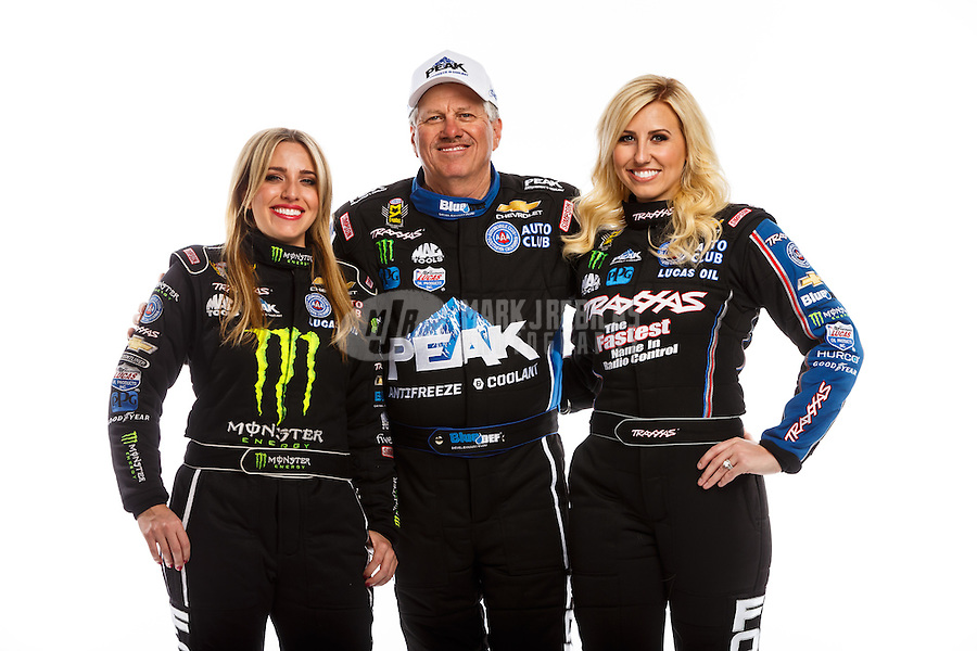 Feb 10, 2016; Pomona, CA, USA; NHRA top fuel driver Brittany Force (left) with father, funny car driver John Force (center) and sister Courtney Force pose for a portrait during media day at Auto Club Raceway at Pomona. Mandatory Credit: Mark J. Rebilas-USA TODAY Sports