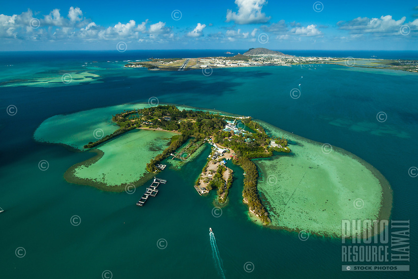 A boat heads towards Coconut Island, a marine research facility, Kane'ohe Bay, O'ahu.