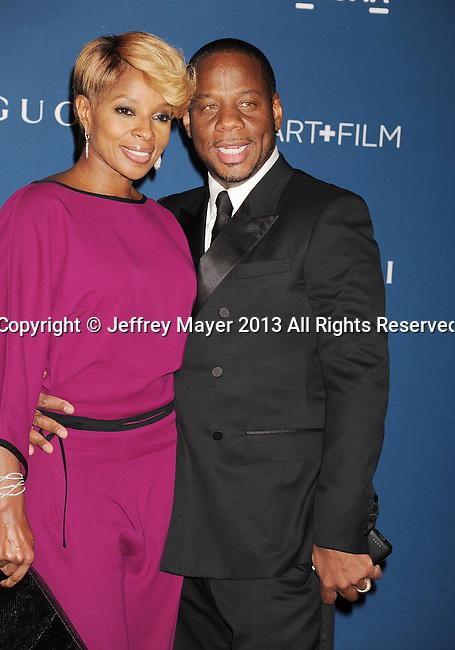LOS ANGELES, CA- NOVEMBER 02: Singer Mary J. Blige and record producer/husband Kendu Isaacs arrive at the LACMA 2013 Art + Film Gala at LACMA on November 2, 2013 in Los Angeles, California.
