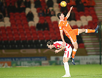 Doncaster Rovers' John Marquis and Blackpool's Ben Heneghan<br /> <br /> Photographer Rachel Holborn/CameraSport<br /> <br /> The EFL Sky Bet League One - Doncaster Rovers v Blackpool - Tuesday 27th November 2018 - Keepmoat Stadium - Doncaster<br /> <br /> World Copyright &copy; 2018 CameraSport. All rights reserved. 43 Linden Ave. Countesthorpe. Leicester. England. LE8 5PG - Tel: +44 (0) 116 277 4147 - admin@camerasport.com - www.camerasport.com