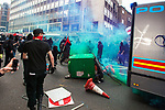 """© Joel Goodman - 07973 332324 . 26/03/2011 . London , UK . A black bloc of protesters carrying black and red anarcho-syndiclist flags clash with police and spray a police van with graffiti on Shaftesbury Avenue . Hundreds of thousands of people attending an anti cuts demonstration under the banner """" March for the Alternative """" in central London , in protest at the coalition government's austerity measures . Photo credit : Joel Goodman"""