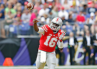Ohio State Buckeyes quarterback J.T. Barrett (16) throws the ball against Navy Midshipmen in the 1st quarter of their NCAA game at M&T Bank Stadium in Baltimore, Maryland on August 30, 2014. (Dispatch photo by Kyle Robertson)