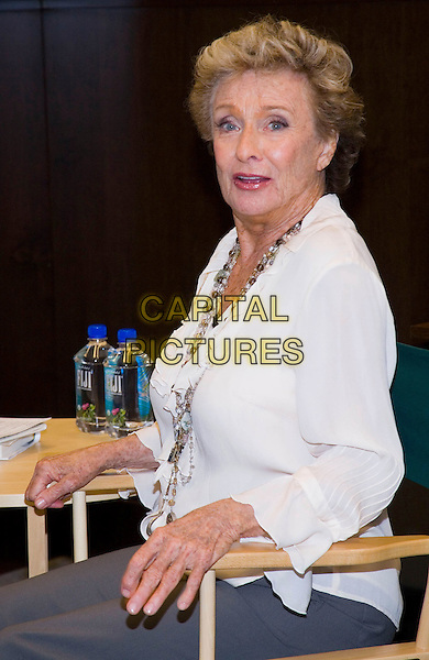 CLORIS LEACHMAN .bookstore appearance signing her autobiography 'Cloris' held at Barnes & Noble at The Grove, Los Angeles, CA, USA, 7th April 2009..half length white cream ruffle sleeved blouse shirt necklaces sitting in chair .CAP/ADM/TC.©T. Conrad//Admedia/Capital Pictures