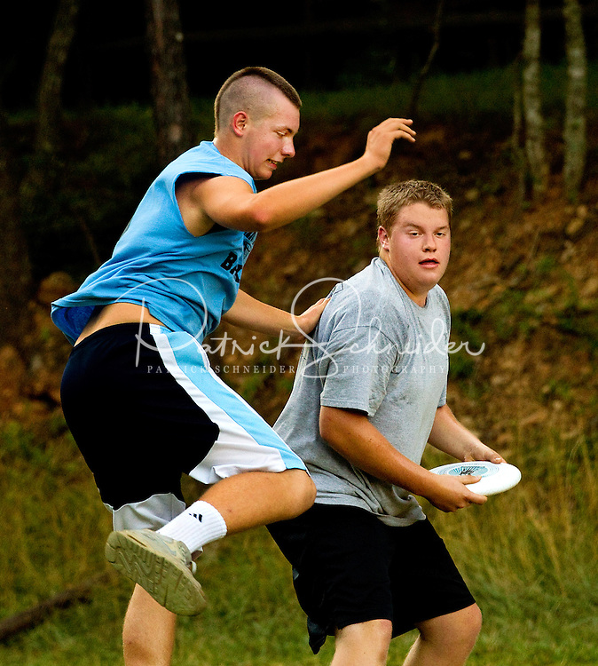 Boy Scouts play a game of extreme frisbee while attending camp at Camp Raven Knob Scout Reservation, one of the largest Boy Scout camps in the United States, is located within Boy Scouts of America's Old Hickory Council in Mt. Airy, North Carolina. Troops from across the US attend the camp's one-week residential boys' summer programs, which offer instruction on more than 40 merit badges, adventure programs and new Scout orientation.