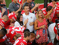 Ohio State Buckeyes head coach Urban Meyer with his wife Shelly and daughter Nicole cheer after singing Carmen Ohio following the Buckeyes 42-7 win over San Diego State in the NCAA football game at Ohio Stadium in Columbus on Sept. 7, 2013. (Adam Cairns / The Columbus Dispatch)
