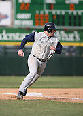 April 15th 2007:  Casey Rogowski of the Charlotte Knights looks for the ball while heading home to score vs. the Rochester Red Wings during International League baseball action.  Photo copyright Mike Janes Photography 2007.