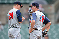 Toledo Mudhens pitching coach A.J. Sager #36 talks with pitcher Casey Crosby #24 and catcher Brad Davis #6 during a game against the Rochester Red Wings on June 11, 2013 at Frontier Field in Rochester, New York.  Toledo defeated Rochester 9-5.  (Mike Janes/Four Seam Images)