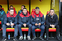 (L-R) Goakeeping coach Tony Roberts, assistant coaches Bruno Lage, Joao Mario Ferreira Oliveira and Swansea manager Carlos Carvalhal sit on their bench during the Premier League match between Watford and Swansea City at the Vicarage Road, Watford, England, UK. Saturday 30 December 2017