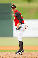 Kannapolis Intimidators relief pitcher Jason Van Skike #25 looks to his catcher for the sign against the Rome Braves at CMC-Northeast Stadium on August 5, 2012 in Kannapolis, North Carolina.  The Intimidators defeated the Braves 9-1.  (Brian Westerholt/Four Seam Images)