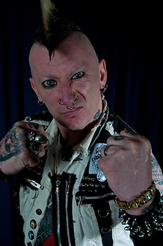 A punk rocker portrait. Shot in a studio.